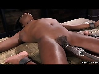 Hairy ebony slave rides fucking machine