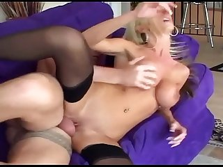 Leggy blonde fucked on a couch in sheer nylon