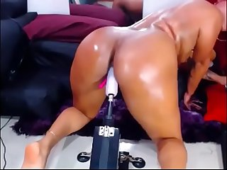 Redhead latina masturabtes dildo machine on cam and has multiple orgasms