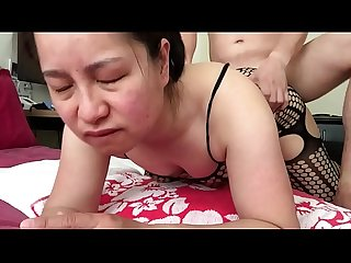 Asian milf talking dirty while getting fucked doggy style
