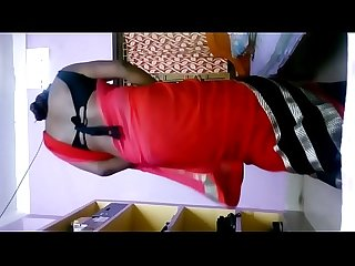 Deepika bhabhi in red hot saree shaking ass in her home