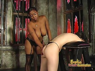 Voluptuous black chick loves spanking her white brunette girlfriend hard