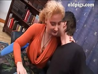 Blonde milf seduces a young boy for fuck