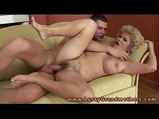 Busty blonde granny pleasured by young dude