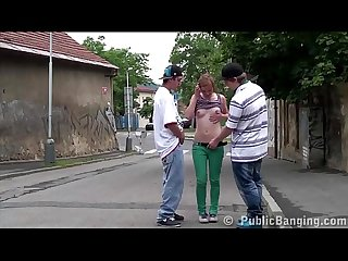 A young local slut is giving it up to a random teen guys on the street