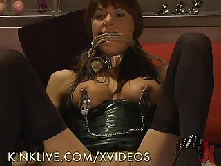 Chained brunette uses a toy