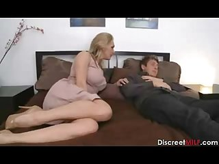 Horny mom with young guy in bedroom