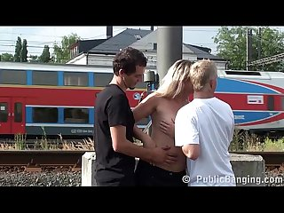 Milf hard public threesome fuck at a Train station by 2 guys