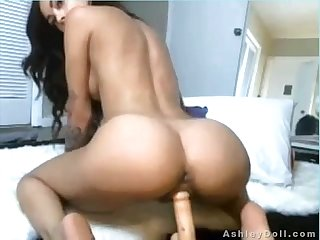 Ashley doll rides a huge dildo