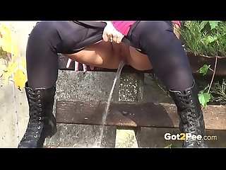 Brunette Hottie Takes Huge Long Piss On Bench In Public