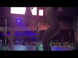 Stripper Little Britches at Allure spreading her legs wide while playing on stage.