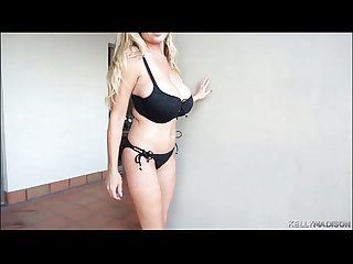 Big tittied milf kelly madison shakes her juggs in a black bikini