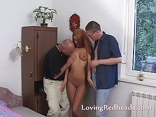 Redhead in for a threesome