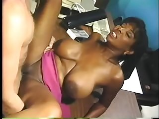 Big breasted beauty Cassandra Curves loves getting fucked by white dick on desk
