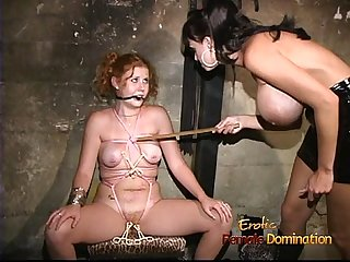Slutty redhead hussy gets clamps on her orgasmic pink slit