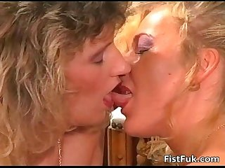 Two mature lesbian sluts having wet fun