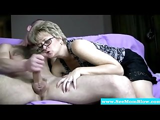Mature lady sucks cock and gets facial