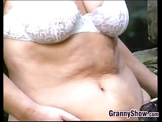 Grandma has sex outdoors with a younger guy