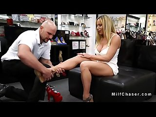 Busty Milf gives footjob to salesman