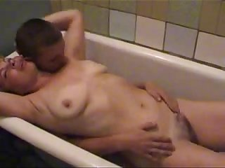 Young guy with blonde mature in bathtube