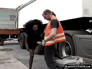 Black hooker riding on mature truck driver outside