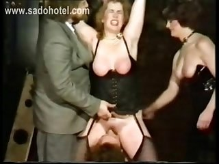 German master forces slave to lick pussy of horny other slave while she got hit with a whip