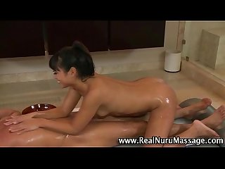Soapy asian masseuse fucks horny client