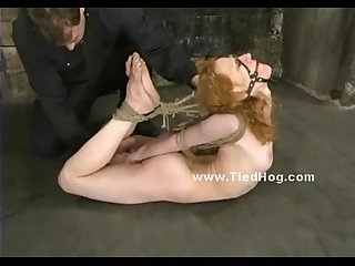 Redhead tied in rope in Various positions in bondage punishment video