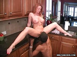 This hot big tit milf is fucked by a black cock