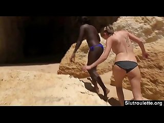 Interracial threesome on the beach