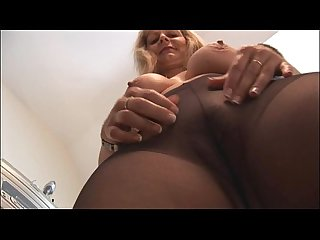 Busty mature blonde in pantyhose and slip