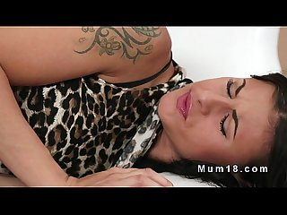 Dark haired mom fucks in armchair