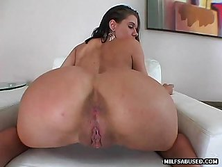 This sexy brunette milf is getting fucked by a big cock