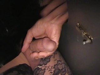 Crossdresser at the gloryhole