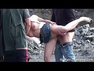 Cute blonde girl is fucked by 2 guys in public at a construction site