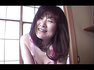 Japanese slutty mom taking her clothes of and rubbing pussy