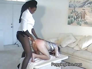 Two massive black muscle women fuck a tiny white guy in the ass with strapon