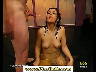 Piss drinking babe gives guys a blowjob and gets a goldenshower
