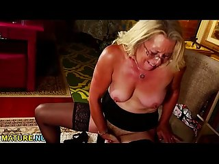 Blonde mature roughly rubbing her hairy pussy