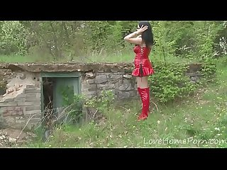 Kinky chick in a red outfit outdoors