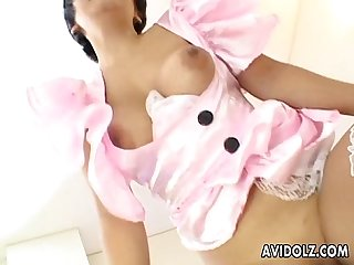 Asian bitch in pink get up and stockings gets doggy styled