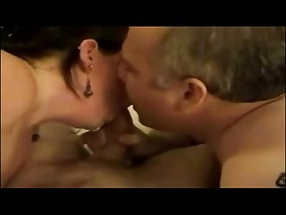 Mature couple having a threesome