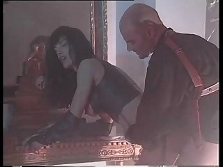 Vintage porn with Venere Bianca in latex dress fucked by two men