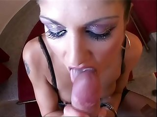 Brunette dressed in leather gives the perfect blow job