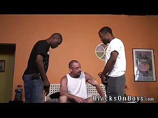 Black thugs sharing a middle aged white guy with moustache