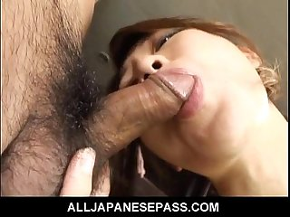 Japanese babe in mesh stockings chokes on cock