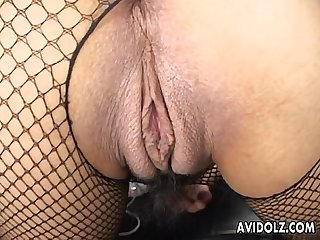 Asian slut with fencenets toy fucks her wet pussy
