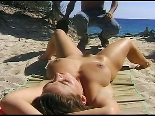 Who is she name of film brunette with big tits gets fucked on the beach