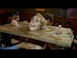 Blonde sex slave brought in public pub in extreme bondage sex