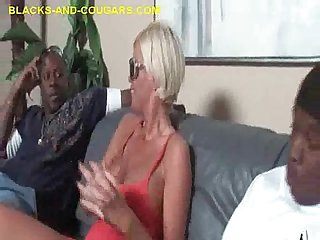 Blonde milf sucks two blacks